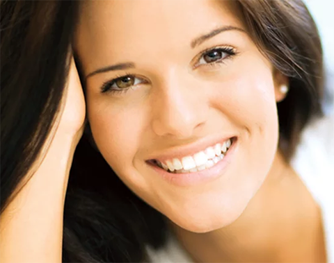 Prettysmiling brunette with white teeth at Jon C. Packman DDS