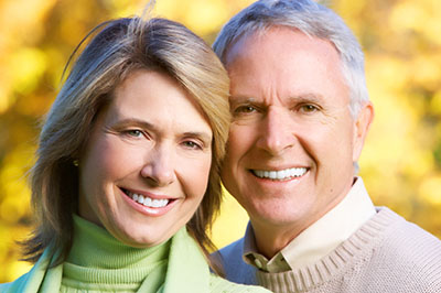Happy couple with white teeth going to Jon C. Packman DDS