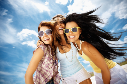 Women are smiling after cosmetic dentistry treatments at Jon C. Packman DDS